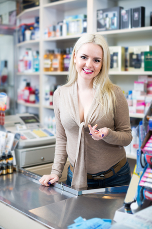 vendor: vendor at counter in perfumery store Stock Photo