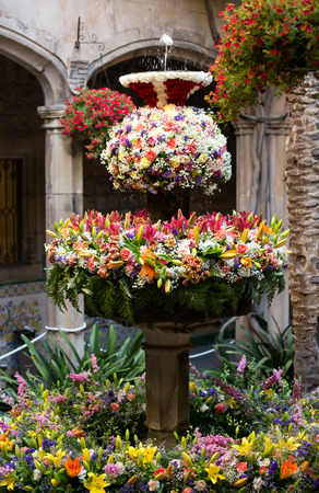 Feast of Corpus Christi. Egg on water in the fountains decorated with flowers at gothic district