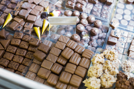 with fillings: Collection of fine chocolate candies with different fillings at tea-room Stock Photo