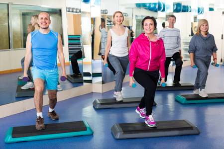 lifestile: Group of senior people stepping  in a fitness club