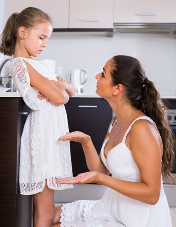 shaming: Upset  american mother shaming daughter for misbehaviour in domestic interior