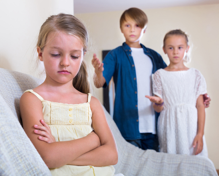 11 years: Envy child sitting aside of boy 11 years old and girl at home
