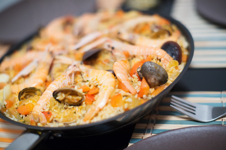 valencian: Delicious Valencian rice dish with seafood paella close up