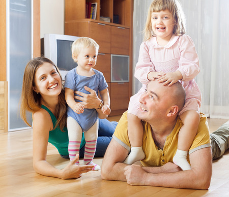 parents with two children at home interior Stock Photo