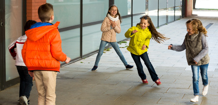 romp: Group of children playing romp game Touch-last outdoors