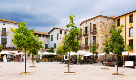olden day: BESALU, SPAIN - MAY 31, 2015:  Day view of town square at Besalu.  Spain