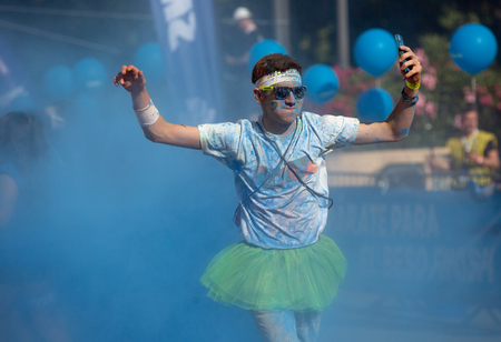trituration: BARCELONA, SPAIN - JUNE 7, 2015: Happy dirty man during   Festival The Color Run in Barcelona Editorial