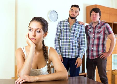 polygamy: Quarrel among adult partners at living room Stock Photo