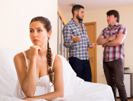 polygamy: Unhappy adult having argue with partners at home