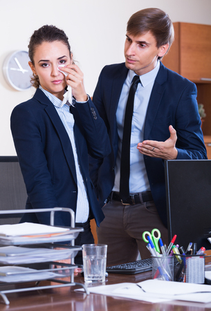 mistakes: Stressed boss scolding employee for work mistakes in  workplace Stock Photo