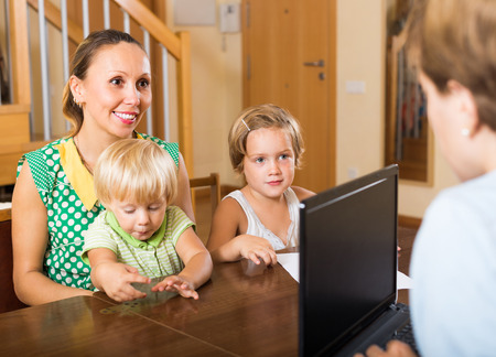 obtain: Agent consulting smiling mother with two kids how to obtain insurance