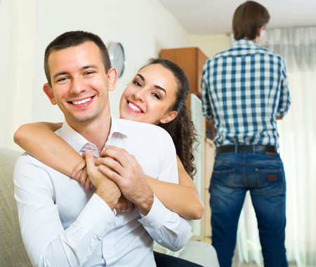 rival: Young man in love triangle: his beloved woman prefers rival Stock Photo