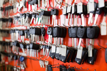 Locksmith stand with variety of car and van keys on hooks Archivio Fotografico
