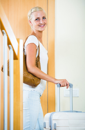 interphone: Portrait of excited spanish female traveller going at holiday trip Stock Photo