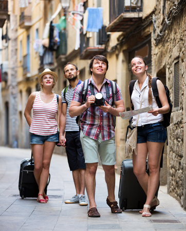 impressed: Company of impressed travelers during city walking. Focus on the right couple Stock Photo