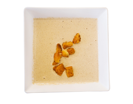 agaric: Creamy agaric soup served with sippets, isolated over white