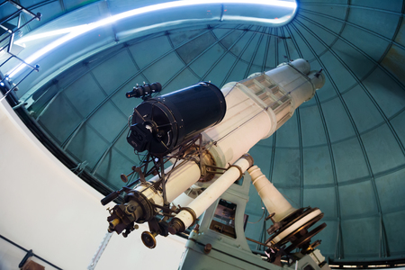huge: Closeup view on huge professional telescope in observatory indoors Editorial