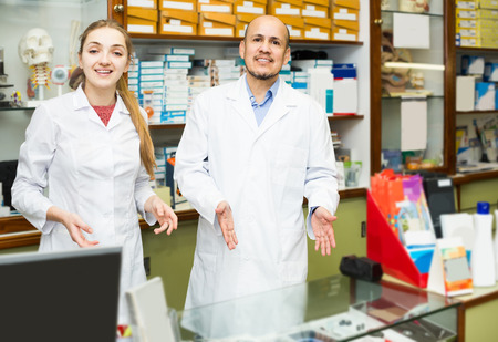 Two positive orthopedists working in special store with orthopaedic goods Stock Photo