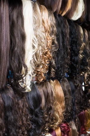 chignon: Assortment of different color human hair extensions in salon