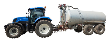 'rig out': Tractor with large wheels and round tank isolated on white background Stock Photo