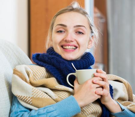 better: Sick girl under blanket feeling better and recovering