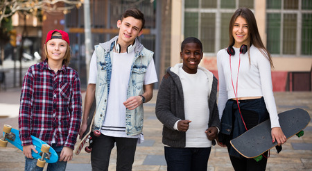 blabbing: Group of teens posing with skateboards in september  day Stock Photo