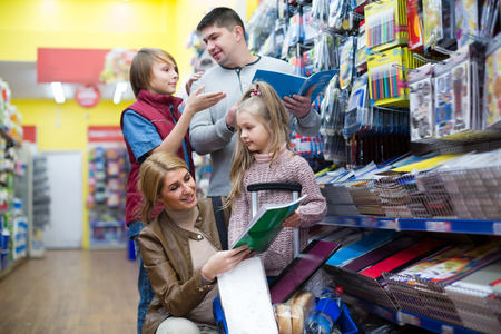 writing materials: Parents and kids buying writing materials in mall