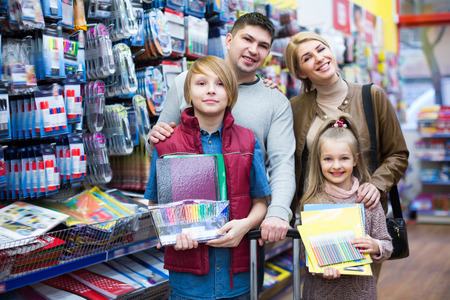 writing materials: Parents and kids choosing writing materials in mall