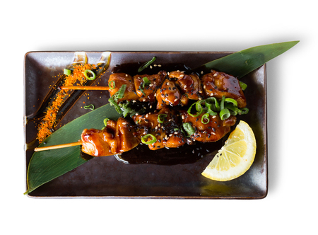 souse: japanise style grilled chicken yakitori beautifully served on the plate isolated