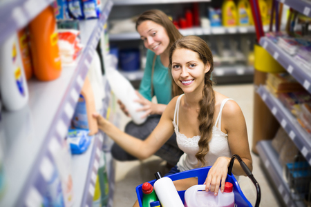 people buying: smiling people buying detergents for house in the shopping mall Stock Photo