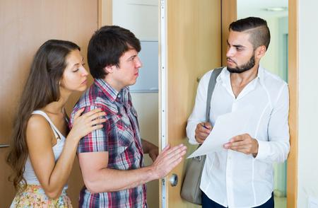 businessman tries hard to make couple pay back a loan