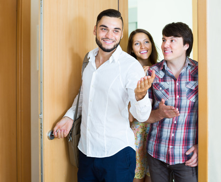 accommodation broker: realtor showing new apartment to young russian couple