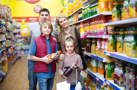 carbonated: Happy family of customers with children purchasing carbonated beverages in store Stock Photo