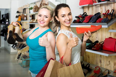 desires 25: Two young cheerful girls shopping together in the fashion store