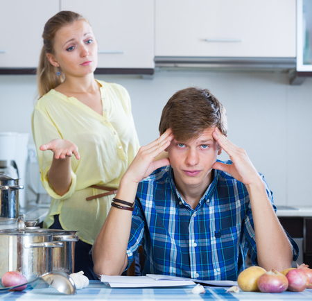 Young woman consulting with husband about the mortgage