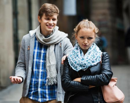 Public harassment: annoying man chasing  irritated  beautiful girl