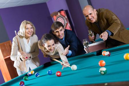pool game: People having pool game in billiard club