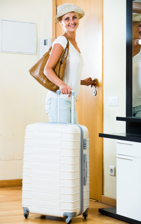 interphone: Portrait of young american female traveller going at holiday trip