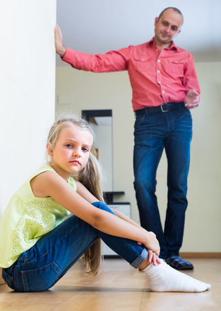 admonition: Worried father giving instructions to frustrated little daughter at home