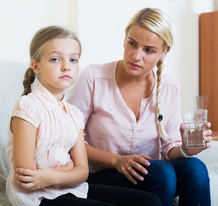 bowels: Portrait of concerned woman and child with abdominal pains