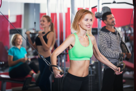 satisfied people: Active satisfied people  weightlifting training in modern health club Stock Photo