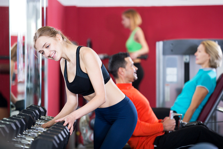 anaerobic: Smiling people of different age having strength training in sport club Stock Photo