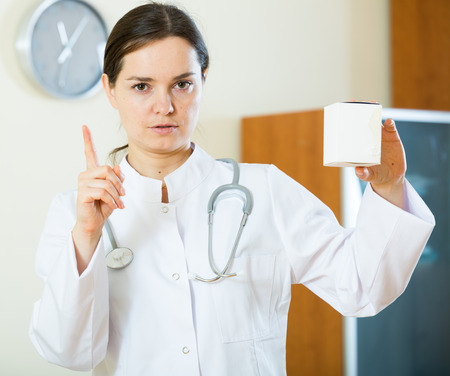 useless: Professional female doctor warning of useless dietary supplement Stock Photo