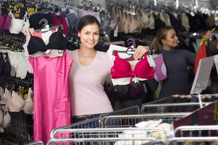 silky lingerie: Woman shopping lace uplifts and panties in lingerie department