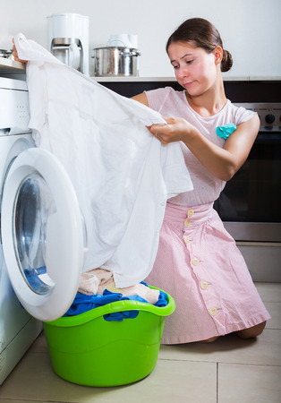 loathsome: Upset young woman cannot wash stains off white shirt