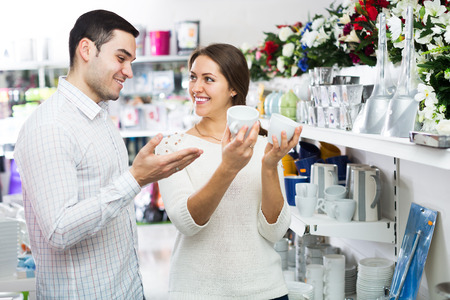 bonny: woman and man chooses ceramic ware in the shop Stock Photo
