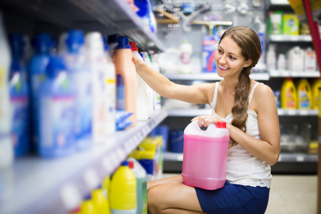 european people: happy european  people choose some detergents in the shop Stock Photo