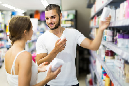 russian man: happy russian man buying cosmetical cream in the shopping mall Stock Photo
