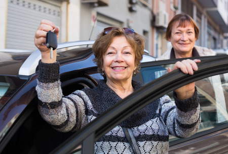 golden age: european driver in golden age standing with car key outdoor Stock Photo