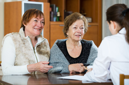 health problems: Senior women discussing health problems with therapeutist in clinic